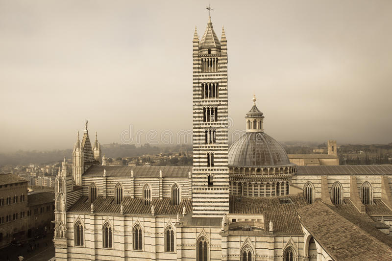 Duomo di Siena and bell tower. View from facciatone Tuscany. Italy. Old polar effect. royalty free stock photography