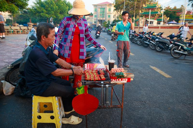 Duong Dong city, Phu Quoc, Vietnam - December 2018: vietnamese street food traders on the street of Phu Quoc island stock photos