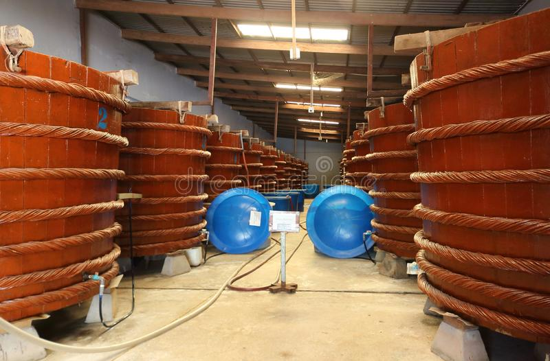 Wooden vats for the production of Vietnamese fish sauce royalty free stock photos