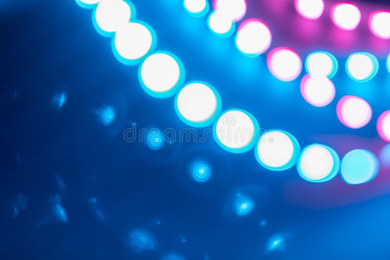 Duotone blue purple Bokeh lights curls and reflections. Festive background of 80s colors.  stock image