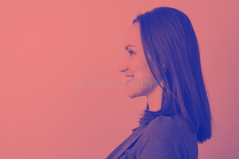 Duotone portrait of a woman in profile with space for text royalty free stock photo