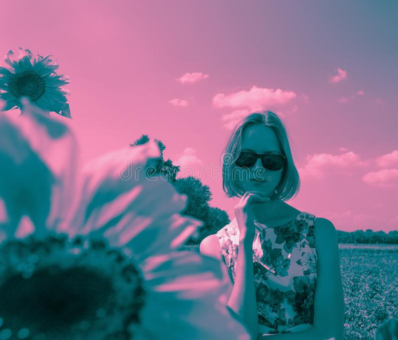 Duotone portrait of young woman in sunglasses stock image