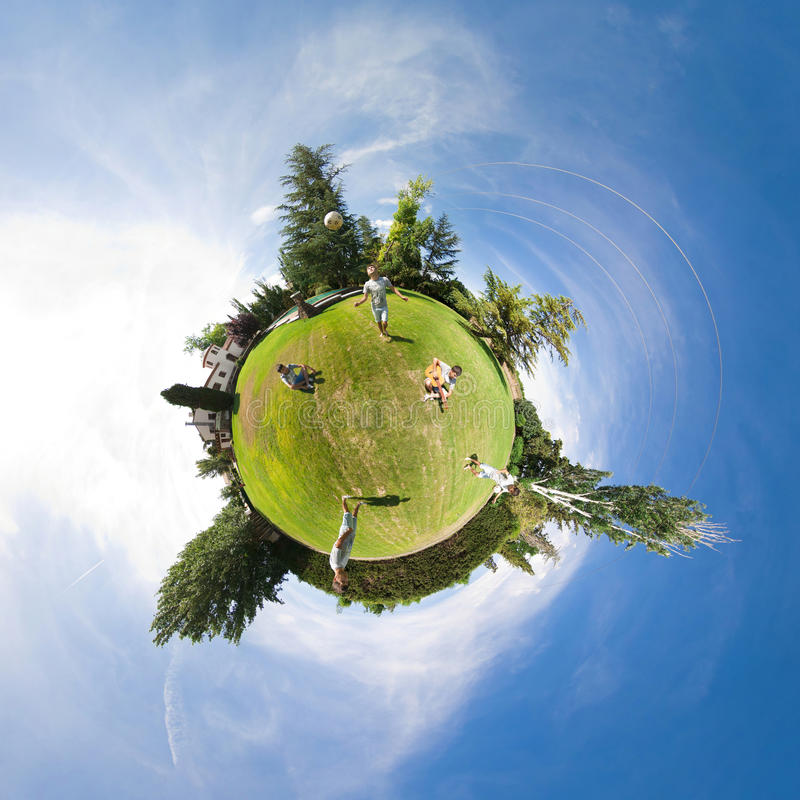Duplicates. Little planet panorama with many duplicates doing various activities on grass stock images