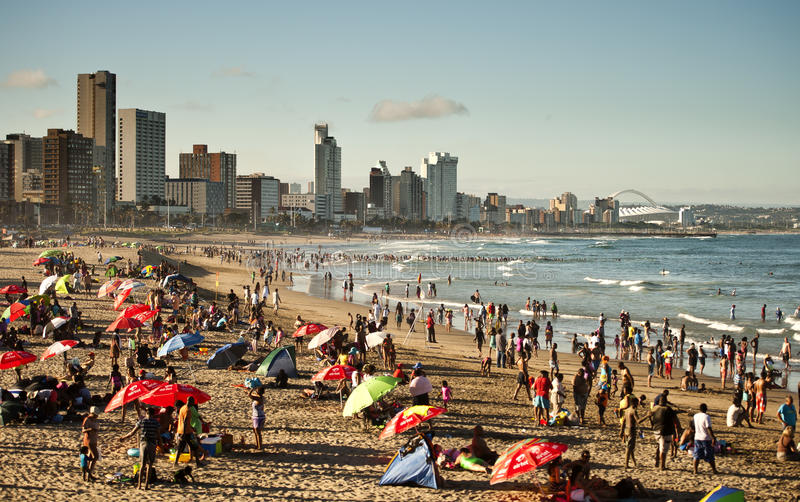 Durban beachfront packed with people. Durban beachfront on a sunny day stock image