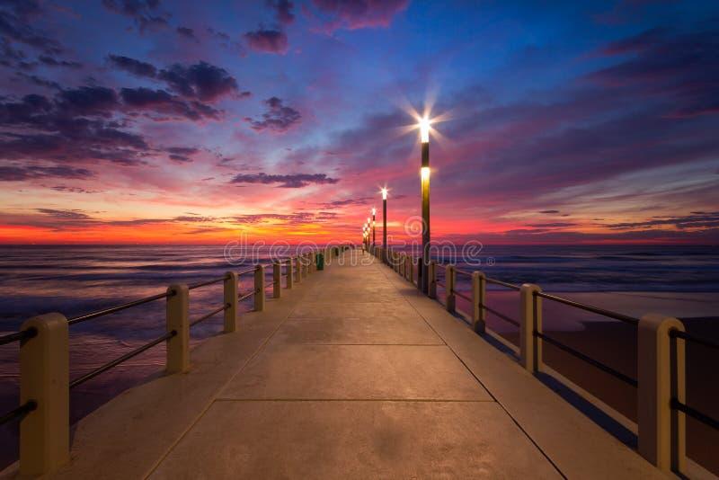 Durban Cityscape sunrise sunset pier blue sky. Durban South Africa Skyline at Sunset sunrise beachfront sand clouds people pier blue sky sunrise water seawater stock photography