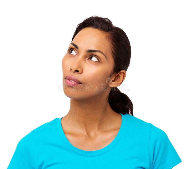 Durchdachte Frau, die Kopien-Raum betrachtet stockbild