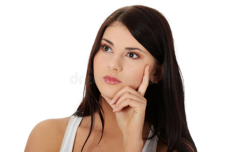 Durchdachte Frau, die nach links schaut stockfoto