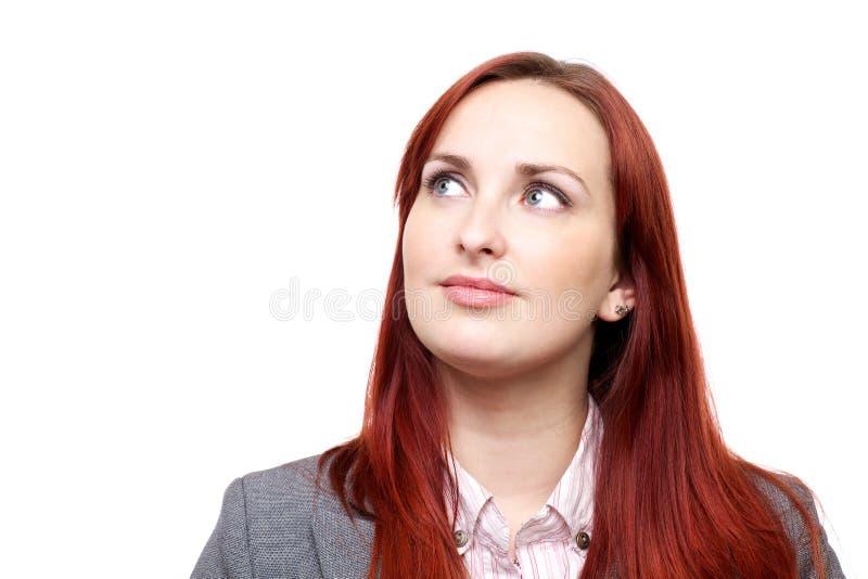 Durchdachte Frau, oben schauend stockbild