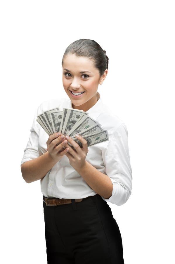 Durchdachte Geschäftsfrau, die Geld anhält lizenzfreie stockfotografie