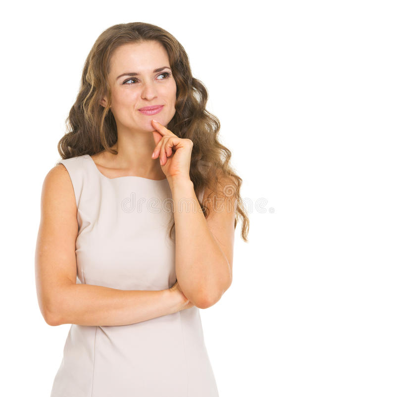 Durchdachte junge Frau, die auf Kopienraum schaut lizenzfreies stockbild