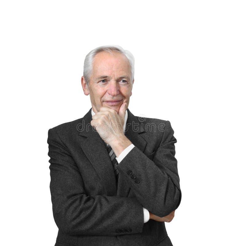Durchdachter älterer Mann hält seine Hand am Kinn lizenzfreies stockbild