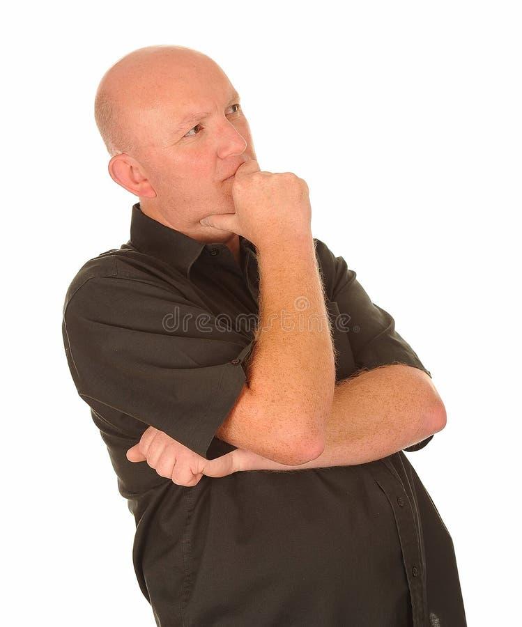 Durchdachter mittlerer gealterter Mann lizenzfreies stockbild