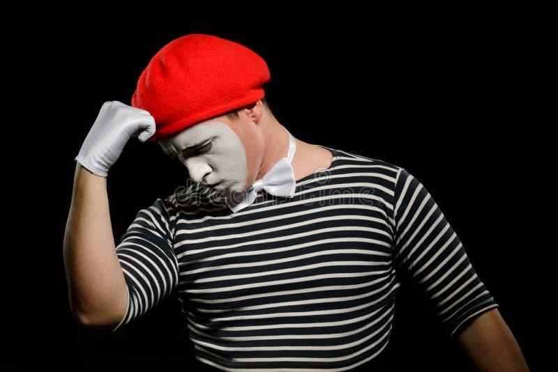 Durchdachter Pantomime, lokalisiert auf Schwarzem lizenzfreies stockbild