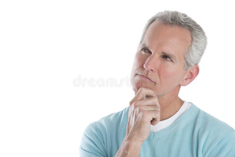 Durchdachter reifer Mann, der weg schaut stockfotografie