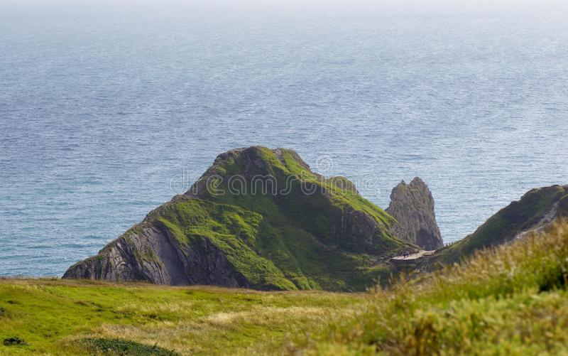 Durdle Door, one of the Jurassic Coast`s most iconic landscapes during summer season stock photos