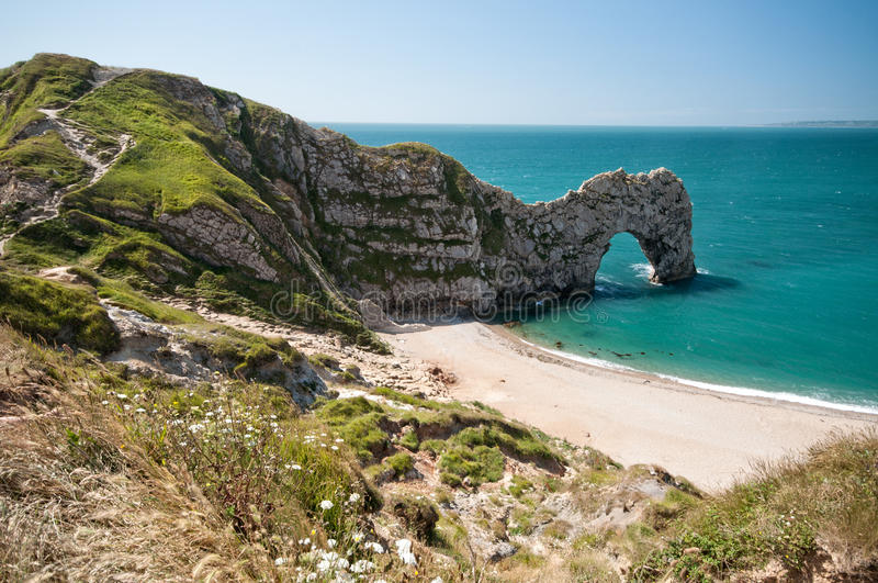 Durdle Door. South West Coastal Path, Dorset, UK. The South West Coastal Path, Dorset. Durdle Door. Part of The Jurassic Coastline of England royalty free stock photo