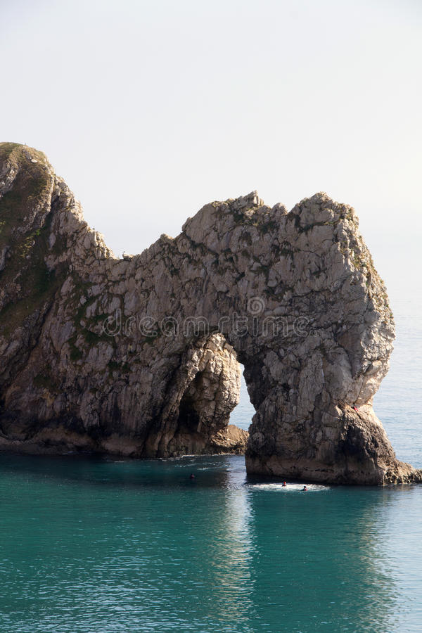 Durdle Dor 3. Durdle Door (sometimes written Durdle Dor) is a natural limestone arch on the Jurassic Coast near Lulworth in Dorset, England. It is privately royalty free stock image