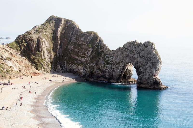 Durdle Dor 4. Durdle Door (sometimes written Durdle Dor) is a natural limestone arch on the Jurassic Coast near Lulworth in Dorset, England. It is privately royalty free stock image