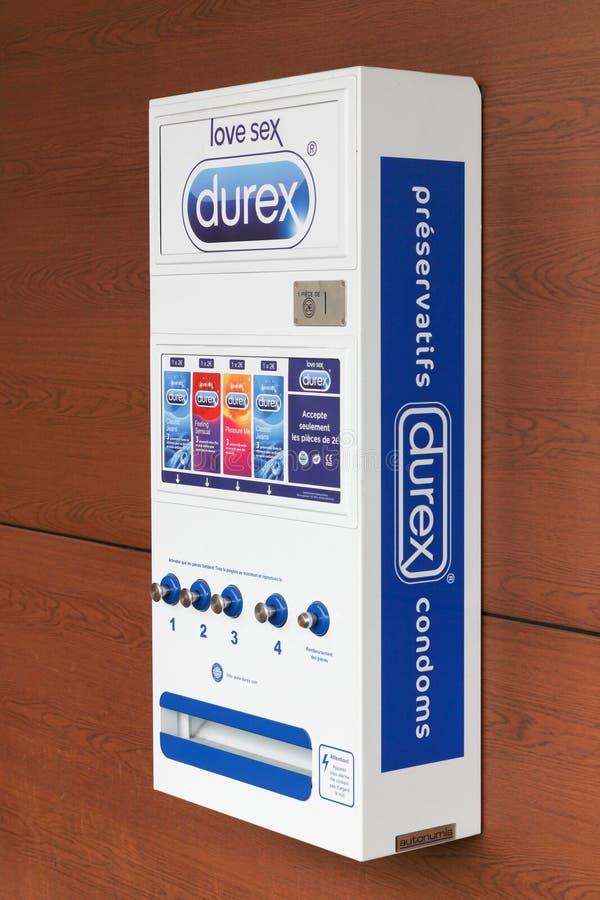 Durex kondomautomatrestaurang på en vägg i Frankrike arkivfoton