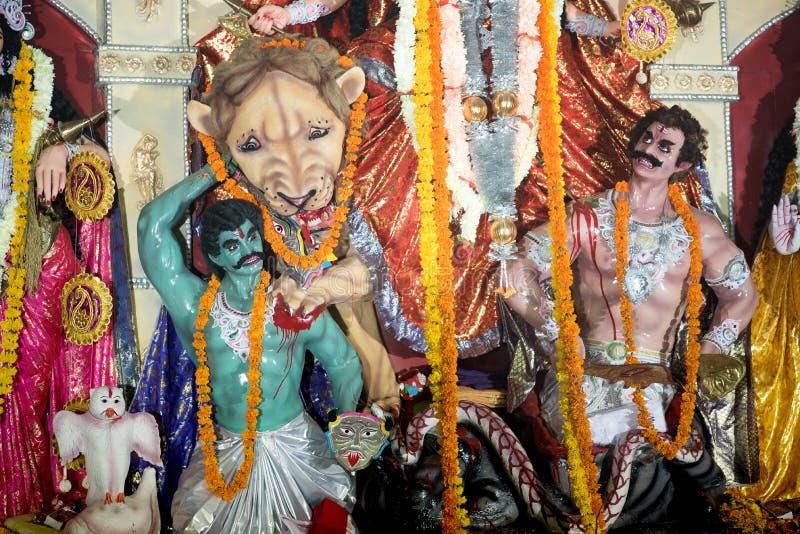 Durga Puja. MUMBAI, INDIA - October 20, 2015: closeup of lion and Asura, in the temporary temple in the city of Mumbai during Durga Puja festival celebration stock photo