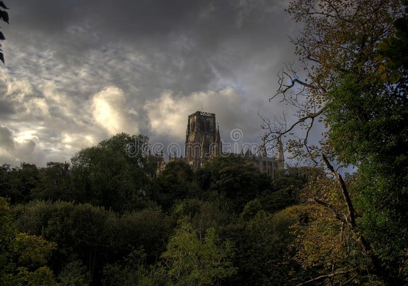 Durham Cathedral. Taken from a town cemetery, beyond the Cathedral grounds against dramatic clouds stock photo