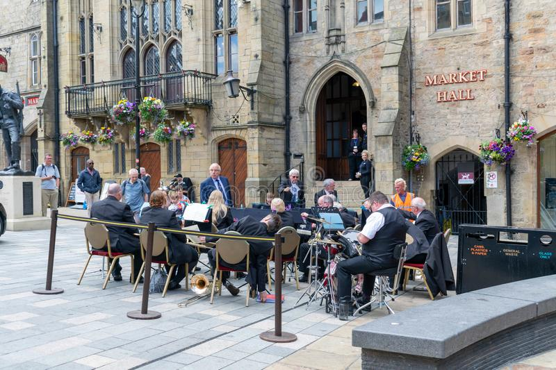 A group of men and women put on a live show in the city centre of Durham stock images