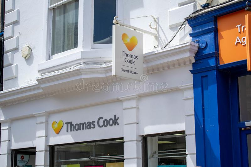 Thomas Cook Group plc is a British global travel company selling holidays and foreign currency royalty free stock photography