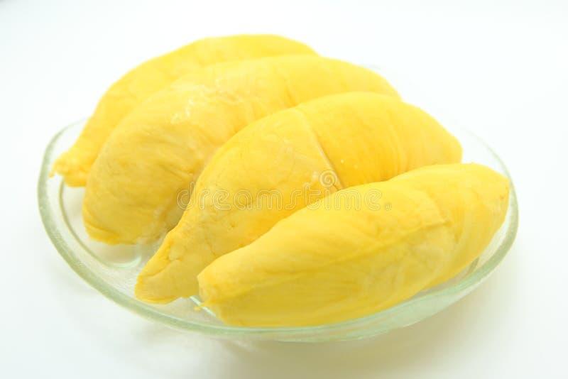 Durian dans le plat sur le fond blanc images stock