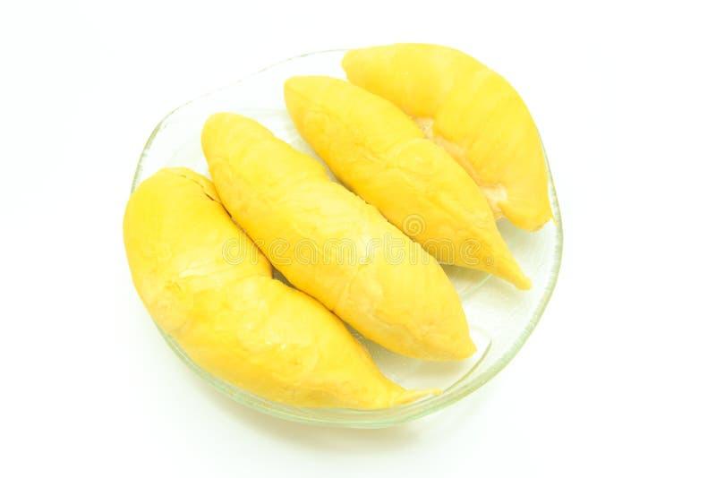 Durian dans le plat sur le fond blanc image stock