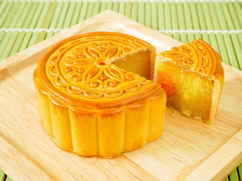 Durian mooncake with egg yolk for Mid-Autumn Festival. Durian mooncake with egg yolk on a wooden plate for Mid-Autumn Festival or Harvest Festival royalty free stock photography
