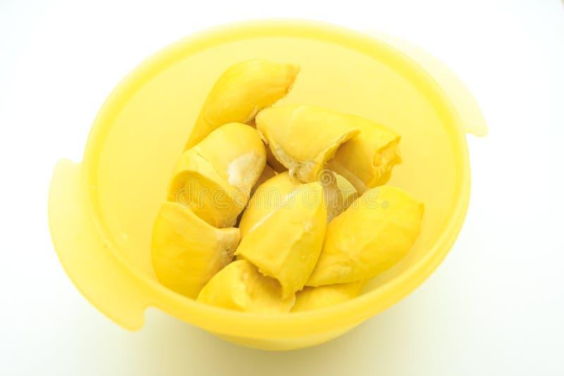 Durian in piatto su fondo bianco immagini stock