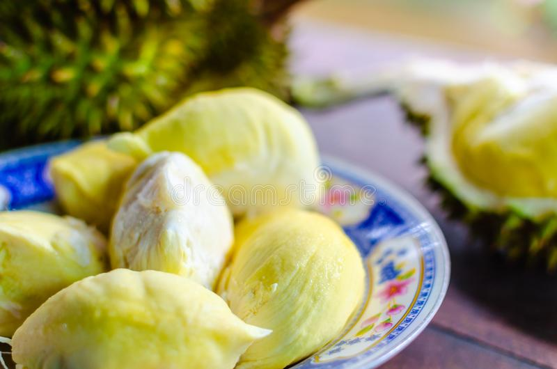 Durian riped and fresh ,durian peel with yellow colour on wooden royalty free stock photography