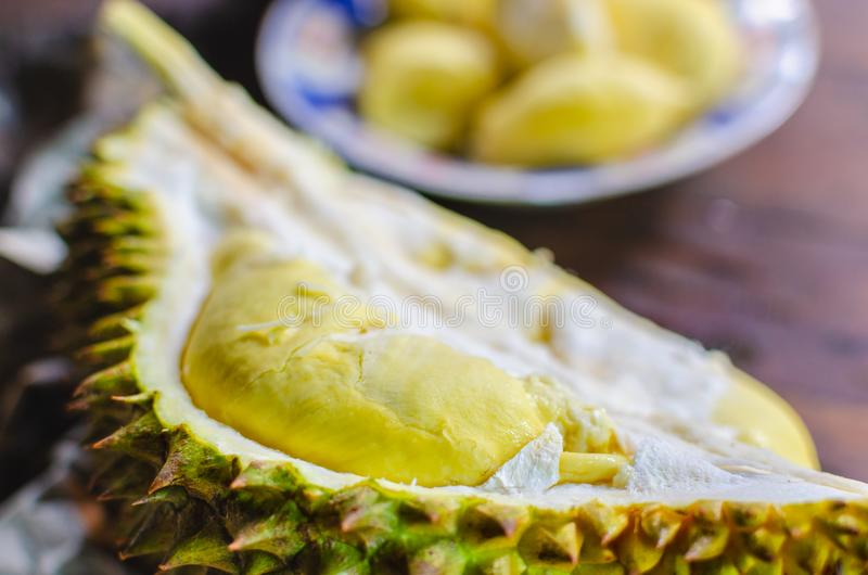 Durian riped and fresh ,durian peel with yellow colour on wooden royalty free stock photos