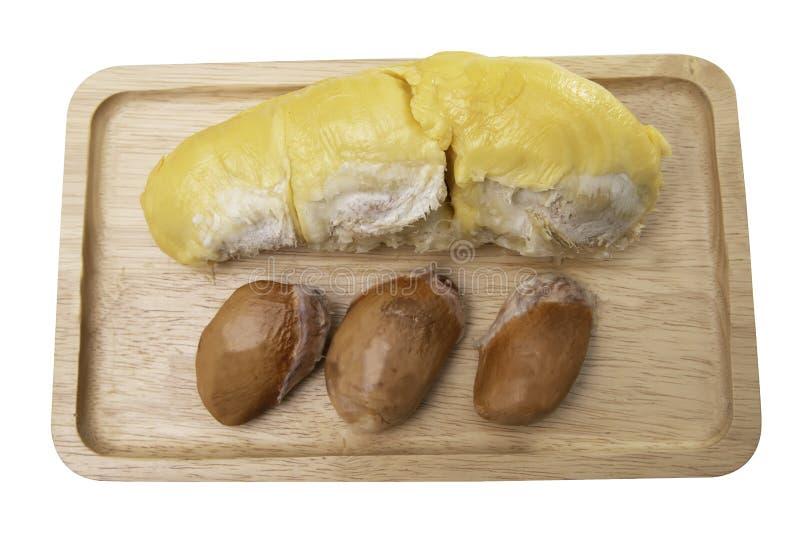 Durian y semillas en las placas de madera foto de archivo libre de regalías