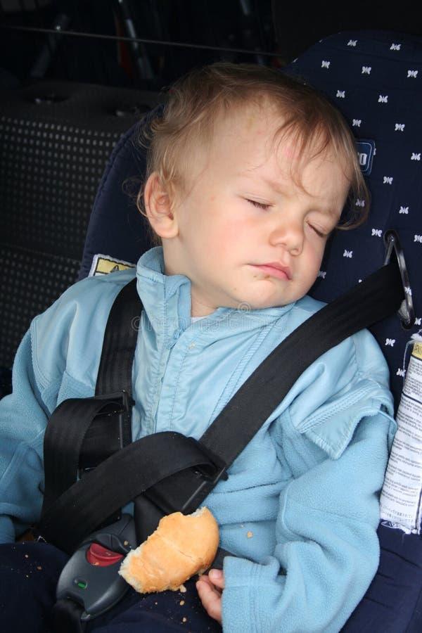 Durmiente del asiento trasero imagenes de archivo