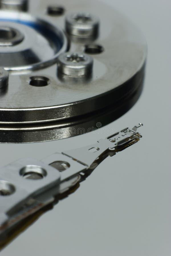 Duro-conduzca el sensor de lectura/grabación y la superficie de disco reflexiva imagenes de archivo