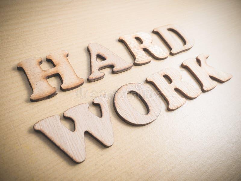Duro lavoro Hardwork, concetto motivazionale di citazioni di parole fotografie stock