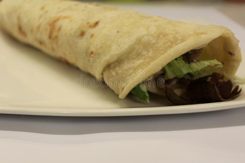 Durum doner kebab. Traditional turkish and arabic wrap. Shawarma durum. Wrap roll bread. Fast food cuisine stock photography