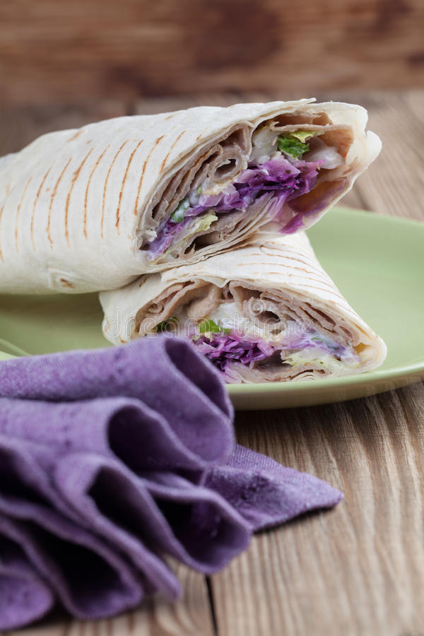Durum kebab. Tortilla wraps with kebab, tzatziki and fresh salad royalty free stock photos