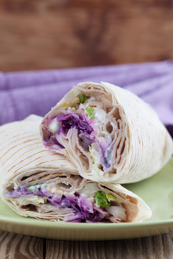 Durum kebab. Tortilla wraps with kebab, tzatziki and fresh salad stock image