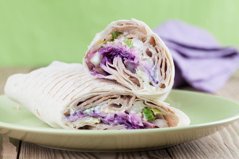 Durum kebab. Tortilla wraps with kebab, tzatziki and fresh salad royalty free stock photography