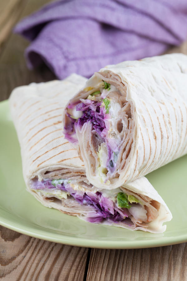 Durum kebab. Tortilla wraps with kebab, tzatziki and fresh salad stock images