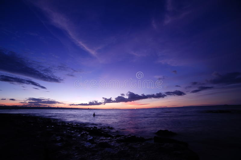 Dusk on the beach Oesapa. Oesapa beach, kupang, Indonesia Country. beauty dusk in the evening, making a beautiful painting make this beach to be one of the ideal stock photos