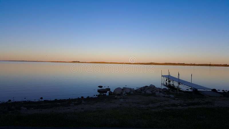 Dusk calm waters royalty free stock photo