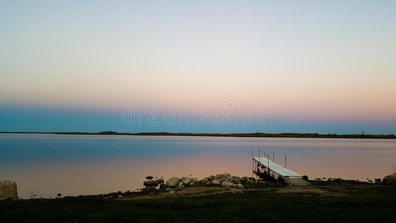 Dusk calm waters stock photography
