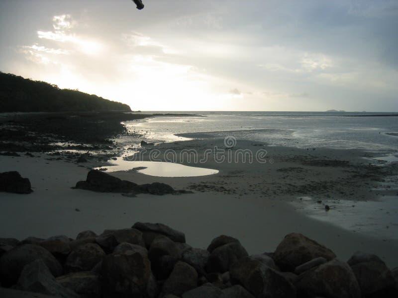 Dusk on a desert island stock images