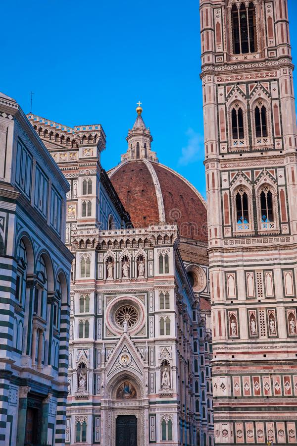 Dusk falls over the Baptistery of St. John, Giotto Campanile and Florence Cathedral consecrated in 1436 stock photo