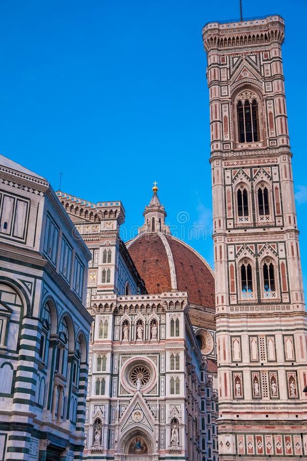 Dusk falls over the Baptistery of St. John, Giotto Campanile and Florence Cathedral consecrated in 1436 stock photography