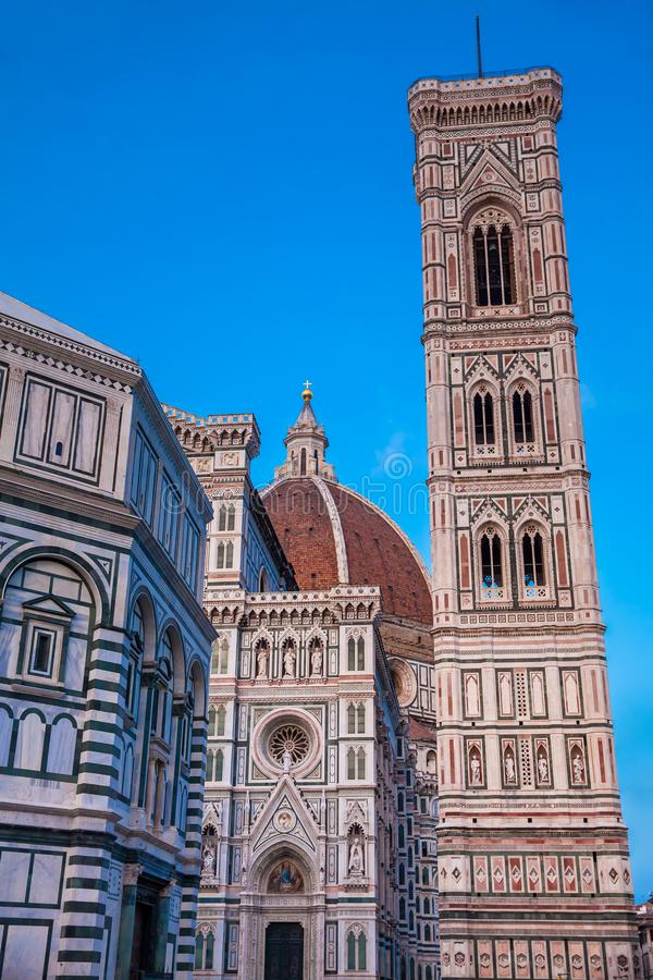 Dusk falls over the Baptistery of St. John, Giotto Campanile and Florence Cathedral consecrated in 1436 stock images
