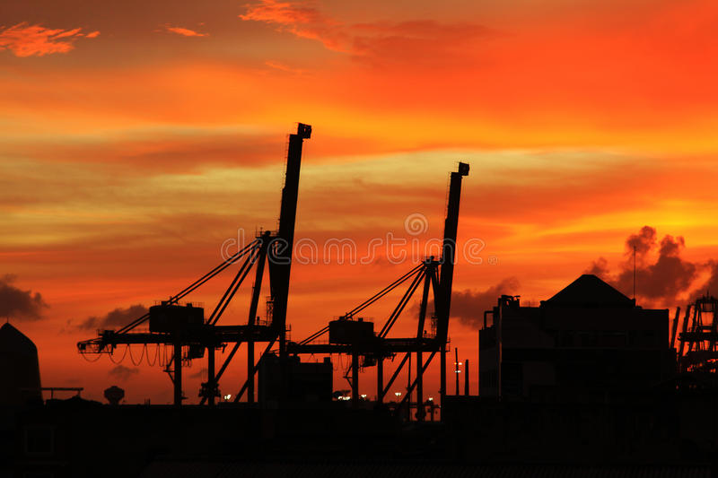 Dusk of Harbor. And the crane stock photos